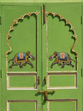 Elephants painted on green door, City Palace, Udaipur, India by Adam Jones