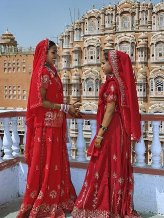 Indian women in color saris, Palace of the Wind, Jaipur, India by Adam Jones