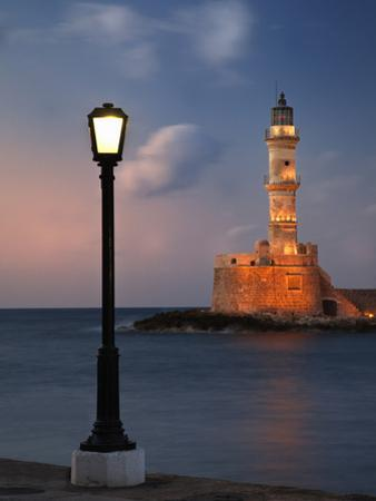 Lighthouse and Lighted Lamp Post at Dusk, Chania, Crete, Greece by Adam Jones
