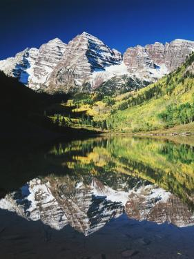 Maroon Bells Reflected in Maroon Lake, White River National Forest, Colorado, USA by Adam Jones
