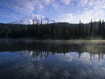 Mt. Rainier Mirrored on Misty Reflection Lake, Mt. Ranier National Park, Washington, USA by Adam Jones