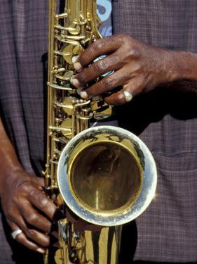 Musicians Hands Playing Saxaphone, New Orleans, Louisiana, USA by Adam Jones