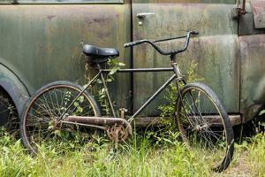 Old fashion bicycle leaning on old truck, Old Car City USA, White, Georgia by Adam Jones