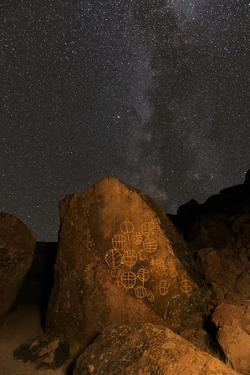 Petroglyphs and Milky Way at night, Great Basin near Mono Lake, California. by Adam Jones
