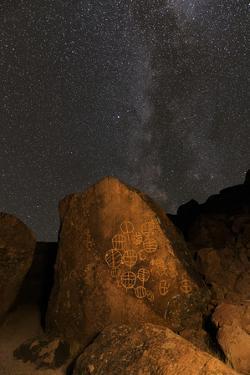 Petroglyphs and Milky Way at night, Great Basin near Mono Lake, California. by Adam Jones