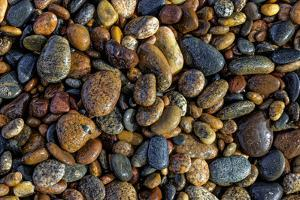 Smooth granite pebbles on beach of Lake Superior, Whitefish Point, Michigan by Adam Jones
