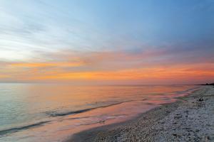 Sunset along beach, Naples Florida by Adam Jones