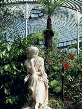 Statue in Glasshouse at the Botanic Gardens, Glasgow, Scotland, United Kingdom by Adam Woolfitt