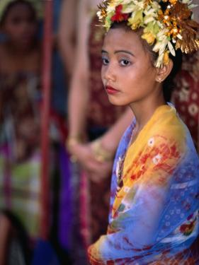 A Young Girl in Costume at the Usaba Sambah Celebration, Tenganan, Indonesia by Adams Gregory