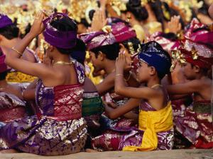 Children and Adults in Traditional Costume Praying at Pura Penataran Agung, Pura Besakih, Indonesia by Adams Gregory