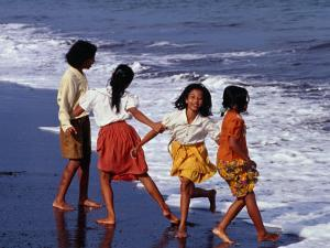 Girls on Lebih Beach, South of Gianyar, Play along the Fringe of Breaking Waves, Indonesia by Adams Gregory