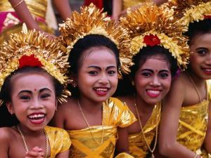 Smiling Faces on Four Young Girls All Dressed Up for a Temple Procession, Indonesia by Adams Gregory