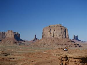 Navajo Lands, Arid Landscape with Eroded Rock Formations, Monument Valley, USA by Adina Tovy