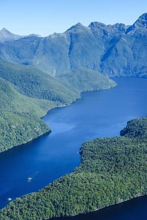 https://imgc.allpostersimages.com/img/posters/aerial-of-a-huge-fjord-in-fiordland-national-park_u-L-PQ8TNN0.jpg?p=0
