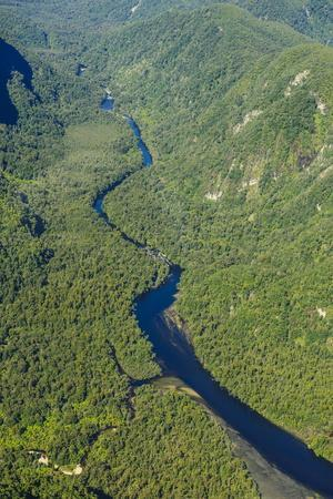 https://imgc.allpostersimages.com/img/posters/aerial-of-a-little-river-flowing-through-the-untouched-mountains-of-fiordland-national-park_u-L-PQ8RQB0.jpg?p=0