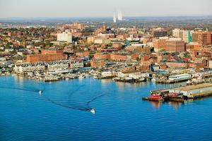 Aerial of downtown Portland Harbor and Portland Maine with view of Maine Medical Center, Commerc...