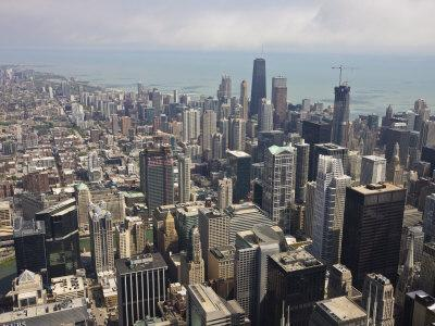 https://imgc.allpostersimages.com/img/posters/aerial-view-of-city-skyline-and-lake-michigan-looking-north-chicago-illinois-usa_u-L-P7O2Y80.jpg?p=0