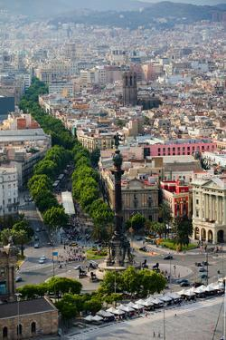 Aerial view of La Rambla near the waterfront with Columbus statue in Barcelona, Spain