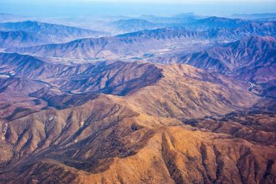 https://imgc.allpostersimages.com/img/posters/aerial-view-of-mountains-atacama-desert-chile_u-L-Q1H23IX0.jpg?artPerspective=n