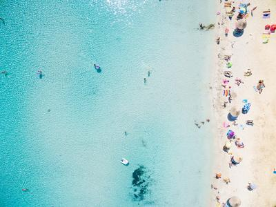 https://imgc.allpostersimages.com/img/posters/aerial-view-of-sandy-beach-with-tourists-swimming-in-beautiful-clear-sea-water_u-L-Q19Y7DU0.jpg?p=0