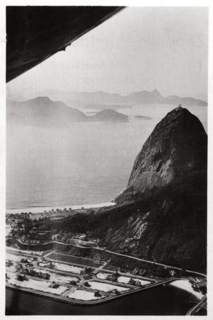 https://imgc.allpostersimages.com/img/posters/aerial-view-of-sugarloaf-mountain-rio-de-janeiro-brazil-from-a-zeppelin-1930_u-L-PTWI1O0.jpg?p=0
