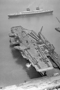 Aerial View of the SS United States Sailing past the USS Forrestal