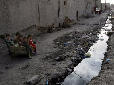 Afghan Children Sit Together Aboard an Old Cart