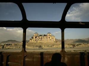 Afghan Drives Past the Darul Aman's Palace in the City of Kabul, Afghanistan