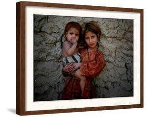Afghan Girl Holds Her Younger Sister in Nangarhar Province, East of Kabul, Afghanistan