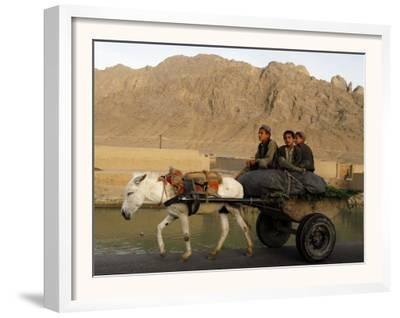 Afghan Kids Ride on a Horse Carriage in Kandahar City, Afghanistan