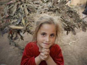 Afghan Refugee Child Looks on in a Neighborhood of Rawalpindi, Pakistan