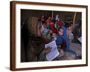 Afghan Refugee Children Holding Copies of the Quran, Repeat after their Teacher