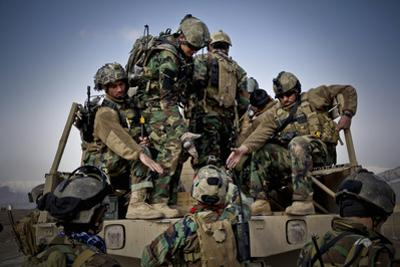 Afghan Soldiers Give a Hand Up to a Fellow Soldier