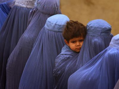 Afghan Women Wearing Burqas Line Up to Vote at a Polling Station in Kabul