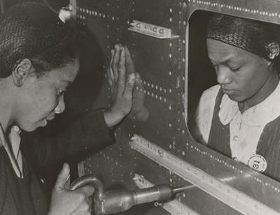 African American Women Riveters Work on the Center Section of a Bomber During World War 2
