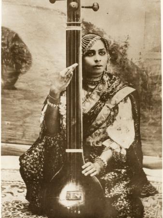https://imgc.allpostersimages.com/img/posters/agra-india-lady-sitar-player_u-L-Q108BT50.jpg?p=0