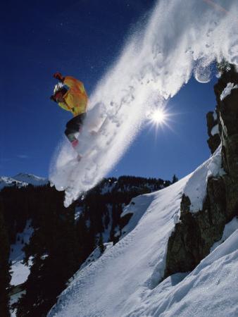 Airborne Snowboarder with Sunburst