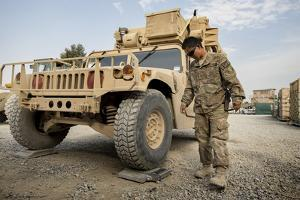 Airman Checks the Weight of a Vehicle in Afghanistan