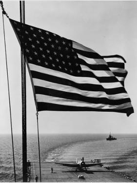Airplane on Battleship Deck with American Flag in Foreground, World War II