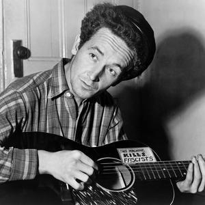 Woody Guthrie (1912-1967) by Al Aumuller