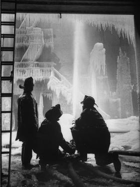 Firemen Fighting a Fire During Icy Weather by Al Fenn