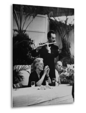 French Music Teacher Nadia Boulanger Listening to Debussey Piece Played During Banquet in Her Honor by Al Fenn