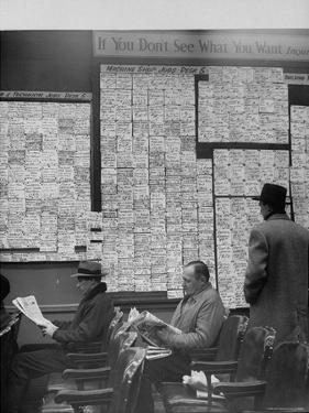 Large Board Containing Small Hand Written Pieces of Paper Announcing Various Jobs and the Salaries by Al Fenn