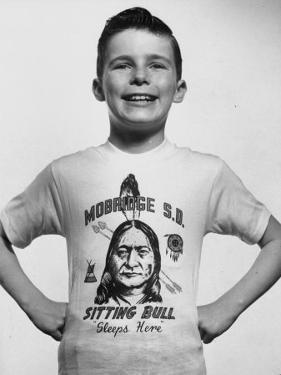Little Boy Modeling Sitting Bull T-Shirt by Al Fenn