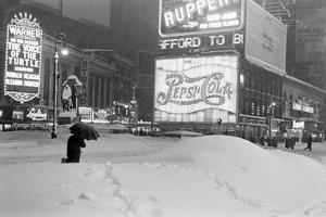 Pedestrians Walking Through Heavy Snow at Night in New York City, December 26-27, 1947 by Al Fenn