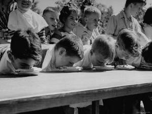 Pie Eating Contest During Church Social by Al Fenn