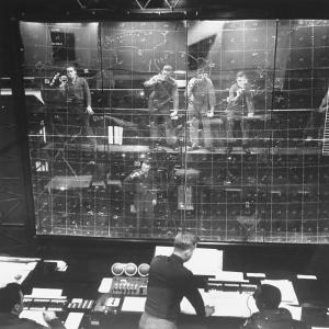 Plotters Writing Data Backward on Plotting Board with Luminous Pencils, Air Defense Control Center by Al Fenn