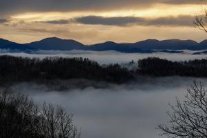 Clouds in the Valleys Below Mountain Ranges and Sunset Skies by Al Petteway