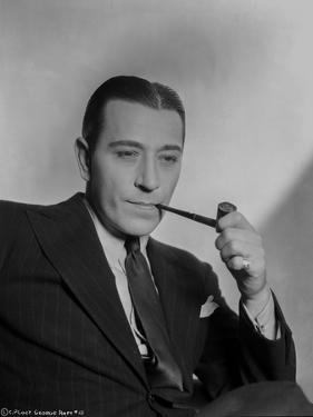 George Raft wearing Black Coat and Tie with Tobacco Pipe by AL Schafer