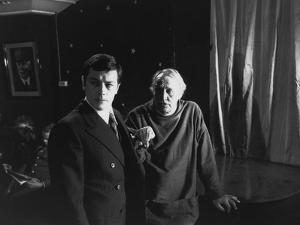 "Alain Delon and director Joseph Losey on set of film ""Monsieur Klein"", 1976 (b/w photo)"